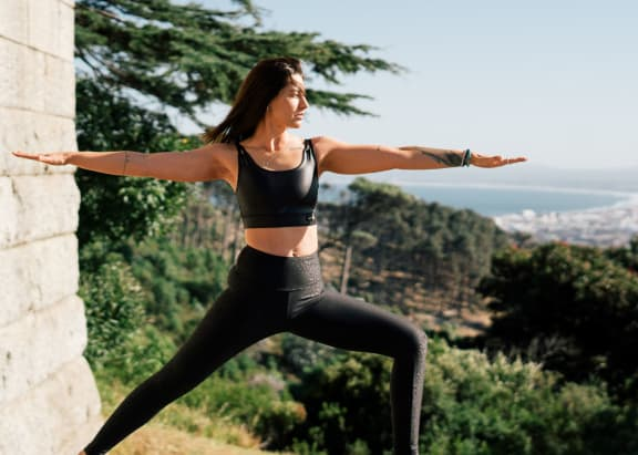 determined_woman_in_yoga_pose at Siena Apartments, Santa Maria, CA, 93458