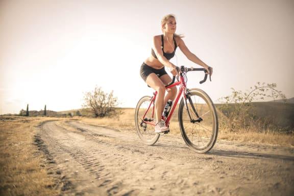 woman_biking_on_trail at Siena Apartments, Santa Maria, CA
