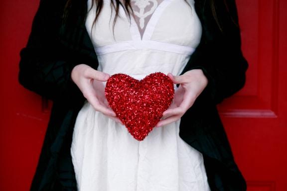 person_holding_red_heart at Spoke Apartments, Atlanta, GA