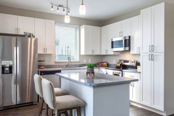 Fitted Kitchen With Island Dining at Tomoka Pointe, Florida
