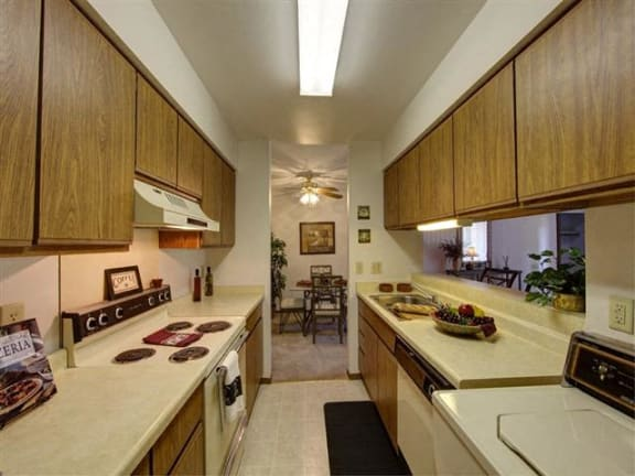 Fully Furnished Kitchen With Stainless Steel Appliances at Stonewood Village Apartments, Madison, WI, 53714