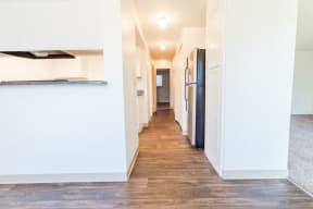 Tacoma Apartments - The Verandas Apartment Homes - Entryway, Kitchen, Living Room, and Dining Room