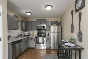 The Slate Model Kitchen and Dining Area