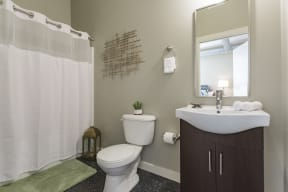 Gale Lofts Spacious Bathroom with Vanity and Large Shower Tub