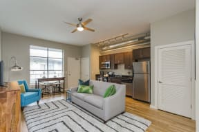 Gale Lofts Open Living Room with Dining Room and Kitchen Access