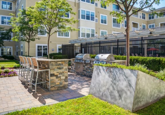 Outdoor grill area and high top near pool