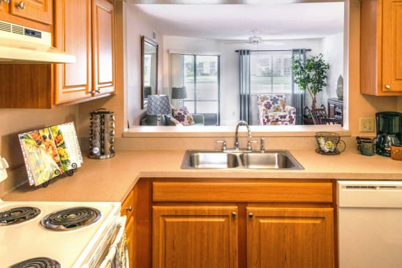 Kitchen with serving hatch at Fishermans Landing apartments in Ormond Beach, FL