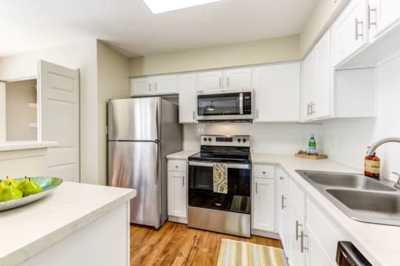 Fully Equipped Kitchen Includes Frost-Free Refrigerator, Electric Range, & Dishwasher at Plantations at Pine Lake, Tallahassee, Florida