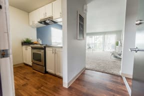 Renton Apartments - The Aviator Apartments - Entryway, Kitchen, and Living Room