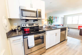 Seattle Apartments - Cadence Apartments - Kitchen and Living Room