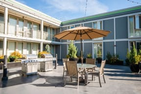 Seattle Apartments - Cosmopolitan Apartments - Common Patio and Gas Grills