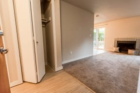 Tacoma Apartments - Notch8 Apartments - Entryway, Hall Closet, Living Room, Fireplace, and Patio