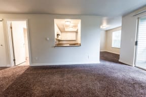 Tacoma Apartments - Sienna Apartments - Living Room, Kitchen, Dining Room, and Deck