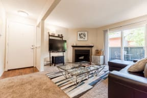 Everett Apartments - Tessera Apartments - Living Room, Entryway, and Deck