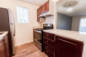 Lakewood Apartments - Bellmary Park Apartments - Kitchen, Living Room, and Deck