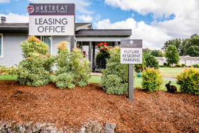 Sumner Apartments - The Retreat Apartments - Leasing Office Exterior and Community Mascot