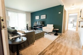 Tacoma Apartments - Aero Apartments - Living Room, Hallway, and Bedroom