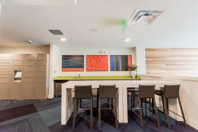 Seattle, WA Apartments for Rent - Icon Apartments Resident Lounge with Flat Screen TV and Cozy Table Seating