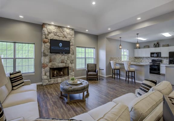 Resident Lounge With Fireplace at Woodland Lakes Apartments, Lansing, MI
