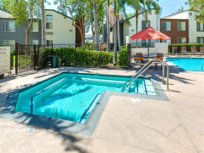 Ontario, CA Apartments - Sparkling Spa Surrounded by Lush Landscaping and Access to Avante Apartment Buildings