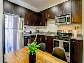 Apartments for Rent Pomona CA - Spacious Kitchen Featuring Convenient and Modern Amenities Such as Fridge, Stove, and Microwave