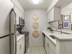 view of apartment unit kitchen with modern appliances
