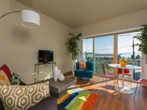 Seattle Apartments - Canvas Apartments - Living Room, Dining Area, and Deck