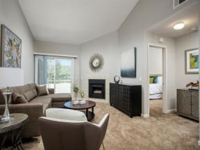 Living area with fireplace and sliding glass doors to patio