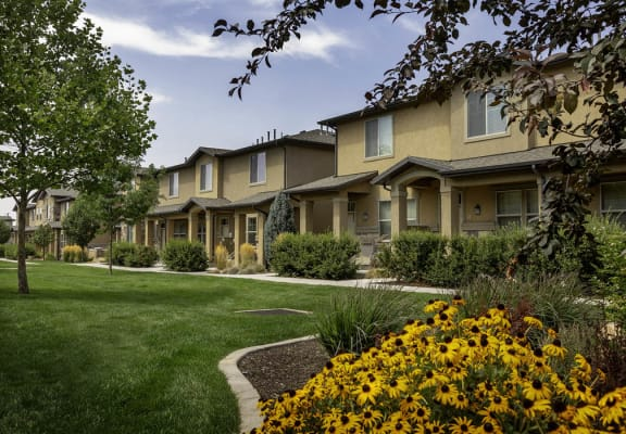 Exterior building & lush landscaping at Four Seasons Apartments & Townhomes, North Logan, 84341