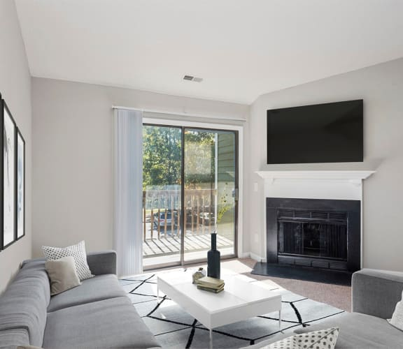 Model apartment living room with fireplace