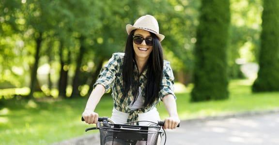 Girl on bike  l Villa Creek Apartments in Santa Rosa CA