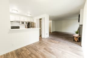 Lakewood Apartments - Crown Pointe Apartments - Dining Room, Living Room, Kitchen, and Fireplace