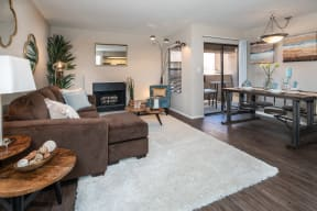 Living area with fireplace and dining area