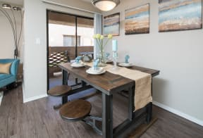 Dining area with sliding glass doors to balcony