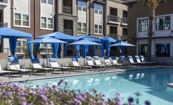 Sparkling pool and cabanas