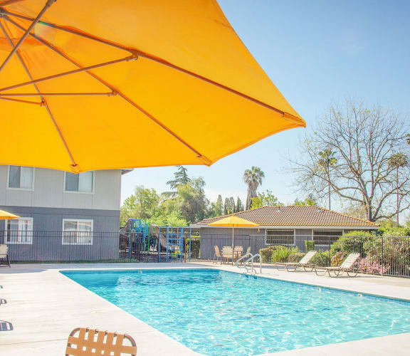 Yellow Umbrella out at Swimming Pool at Courtyard at Central Park Apartments in Fresno, CA 93722