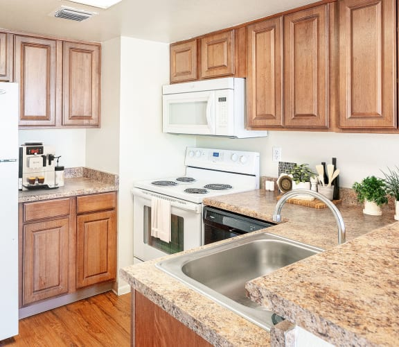 Kitchen with updated appliances at Rio Seco Apartments in Tucson, AZ 85746