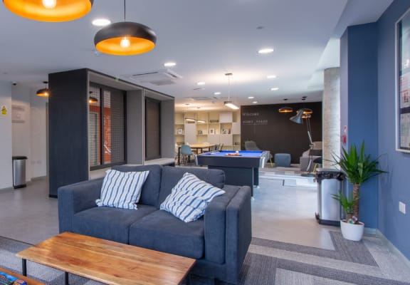 Sofas and games area in apartment building