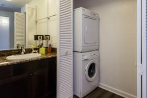 Lavatory area with washer/dryer closet