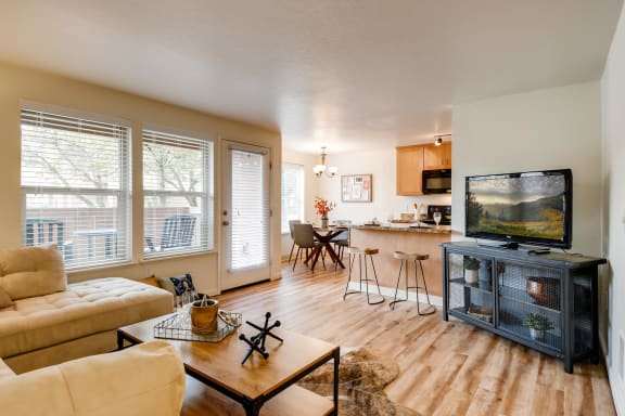 Apartments in Happy Valley - Sunnyside Village Apartments Bright, Open Living Room with Hardwood Floors and Patio Access