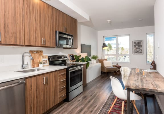 Hawthorne Apartments Model Kitchen with Table and Living Room