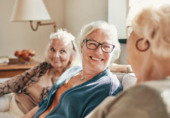 Women laughing at Woodlands at Forbes Lake Apartments in Kirkland WA