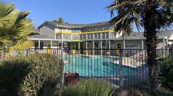View of pool area and exterior building