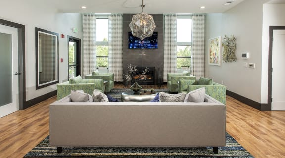 Clubhouse seating with TV l Waterscape Apartments in Fairfield CA