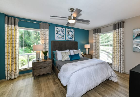 bedroom with large windows plank floors and model furnishings at Berry Falls Apartments, Vestavia Hills, AL, 35216