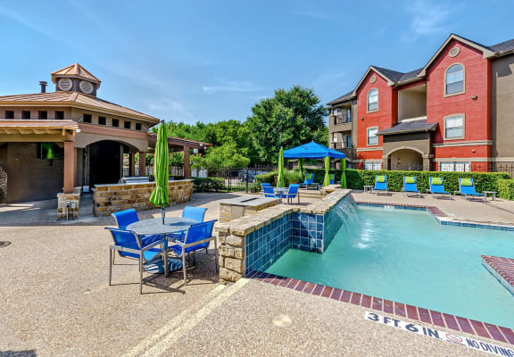 Swimming pool at Hidden Creek Apartments in Lewisville, Texas.