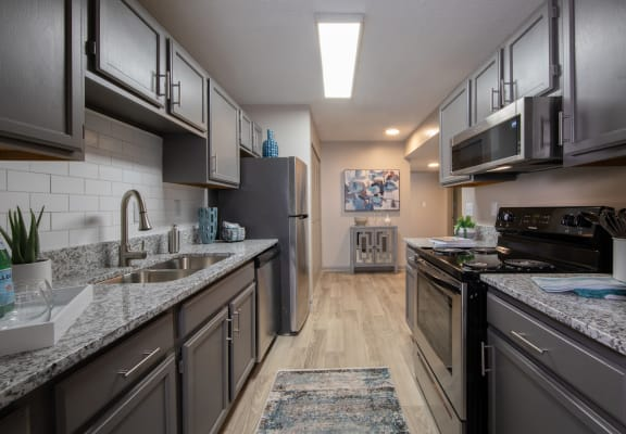 stylish kitchen with granite countertops and stainless steel appliances