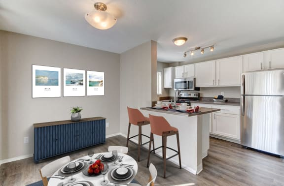 Kitchen with stainless steel appliances and dining area