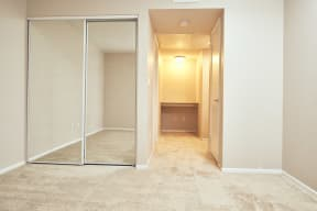 Alta Vista Apartments in Escondido, CA with Wall to wall carpet, mirrored closet, white walls, window
