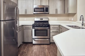 Apartments for Rent in Escondido, CA - Alta Vista Kitchen with stainless steel appliances, and modern wood cabinets